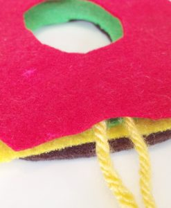 put the felt together | Stack the Felt Layers to Make a Burger Pom Pom | Make a Pom Pom Burger out of Yarn | Pop Shop America DIY Blog