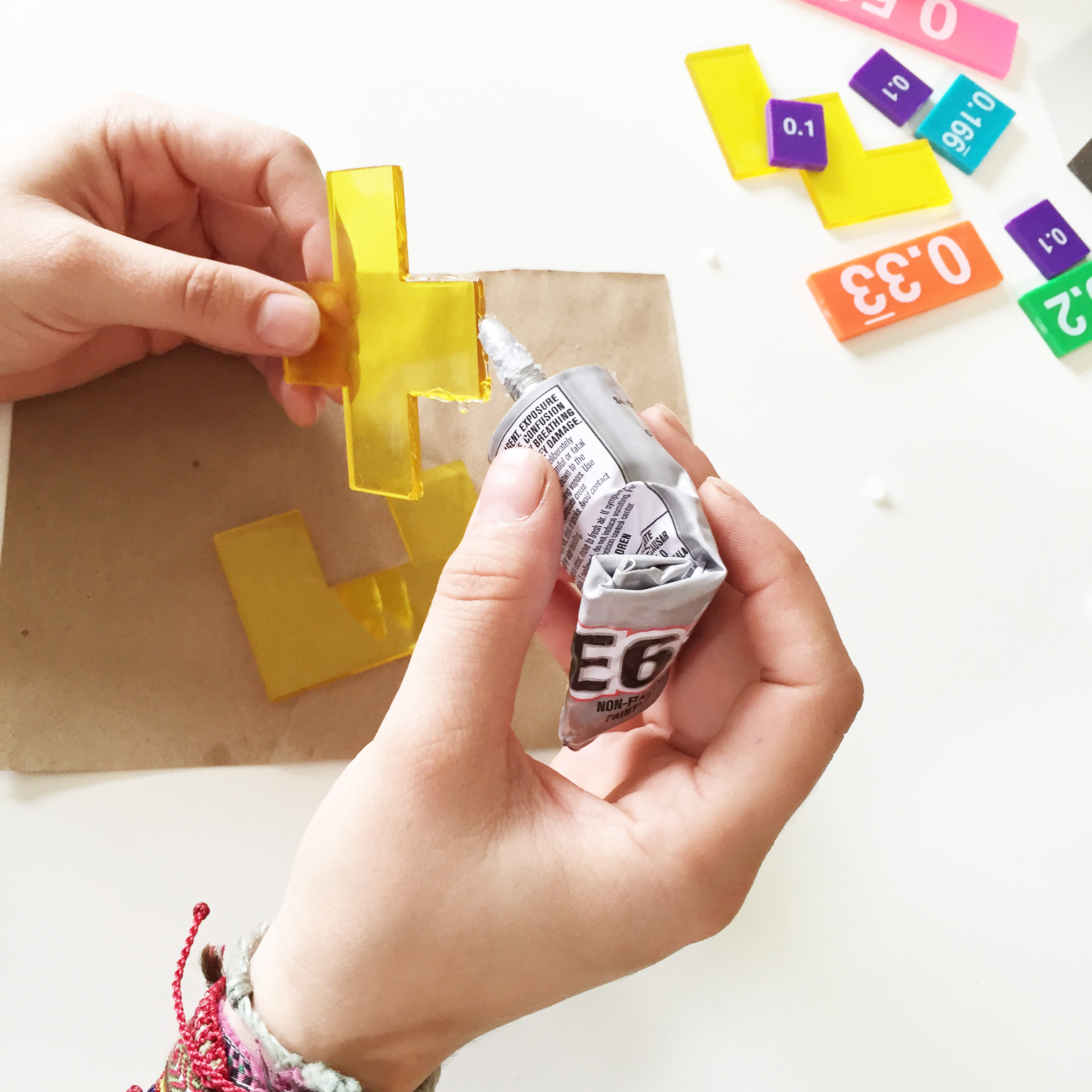 Gluing the Tangram Pieces | How to Make Geometric Coasters | Things to Do with Tangrams from the Pop Shop America Art Blog | Homemade Gift Ideas