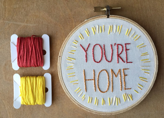 Embroidery Hoop that reads You're Home! This hoop is handmade by Bedthread and available for purchase at Pop Shop America.