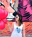 cristina-with-balloons-1 | T Shirt by Stovepipe and heart sunglasses available at Pop Shop America Shop Local Boutique