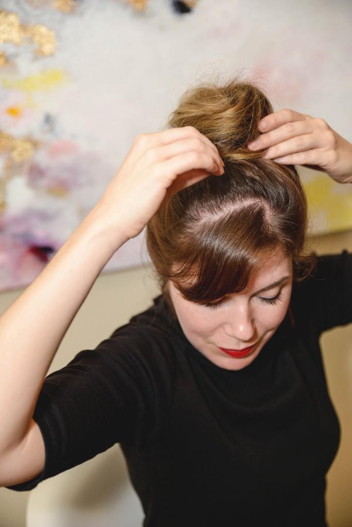 twist your hair up into a bun piet mondrian updo