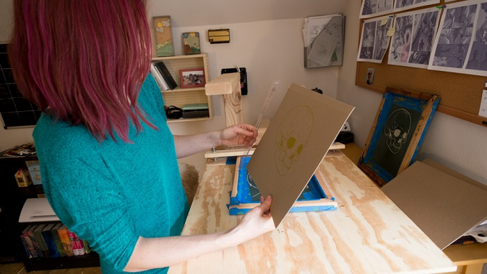 Lauren Feehery el Fury etsy shop handmade art in houston in her studio with skull print