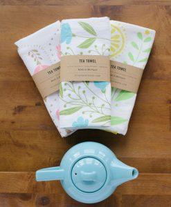 mason jar with flower bouquet in blue tea towel lifestyle photo