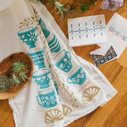 tea cups & gold ivy tea towel feature image pop shop america