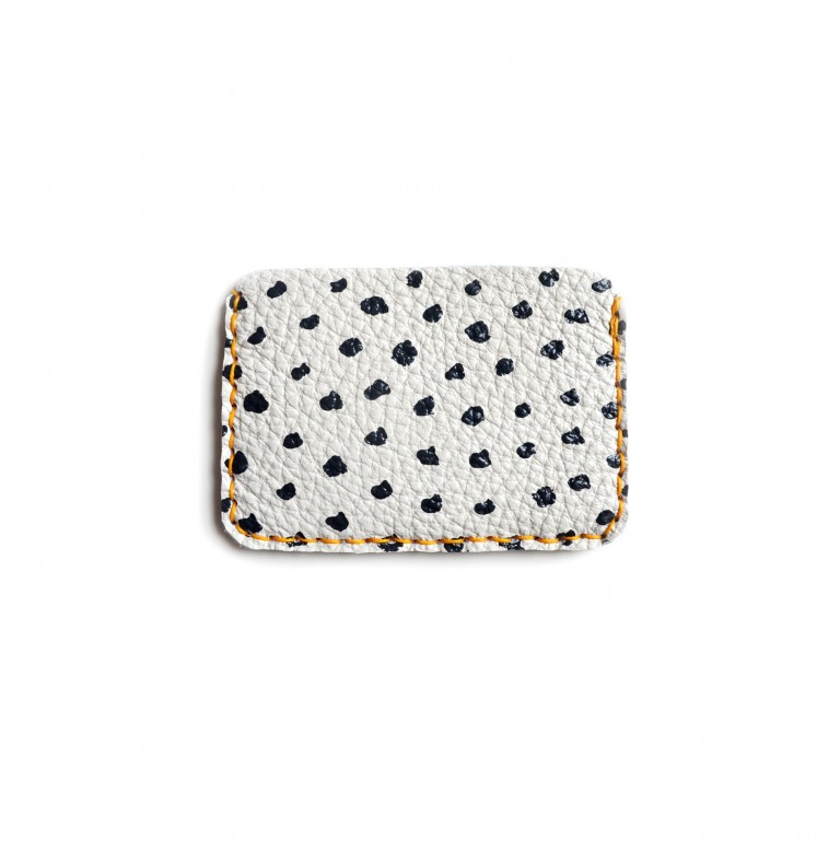 back of black and white leather wallet with polka dots handmade leather goods