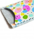 detail of rainbow amoeba leather card holder handcrafted leather goods