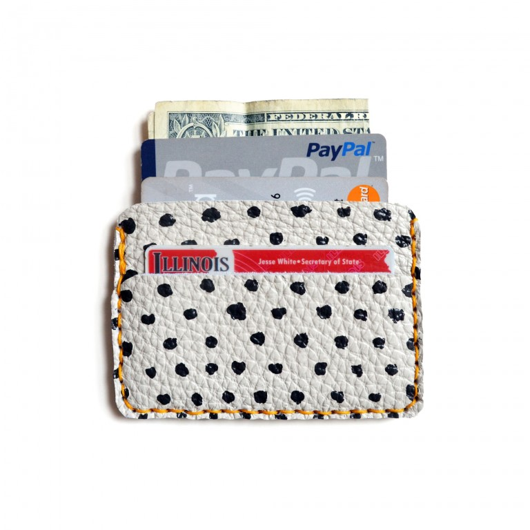 hero photo of handcrafted black and white leather wallet with polka dots