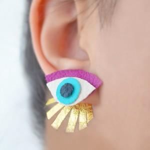 purple seeing eye stud earrings leather earrings