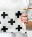 swiss cross leather clutch front