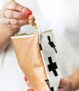 swiss cross leather clutch side view