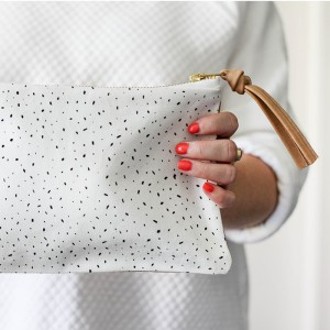 white specks leather clutch front detail leather goods