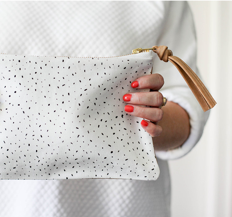 white specks leather clutch front detail shop leather goods online