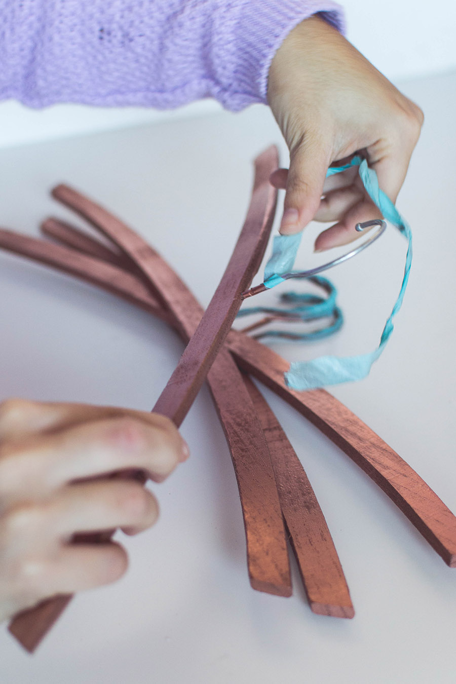 DIY rose gold hangers: remove the washi tape