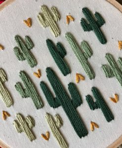 close up of multi cactus embroidery hoop art handmade in austin tx