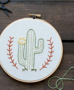 detail of flowering desert cactus embroidery hoop art