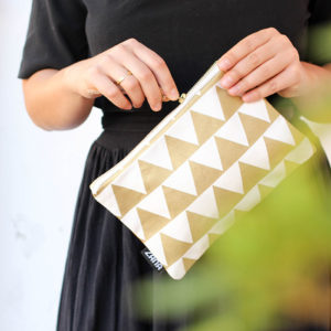 detail of gold triangle leather clutch purse