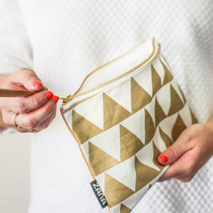 zipper closure on gold triangle leather clutch by zana south africa