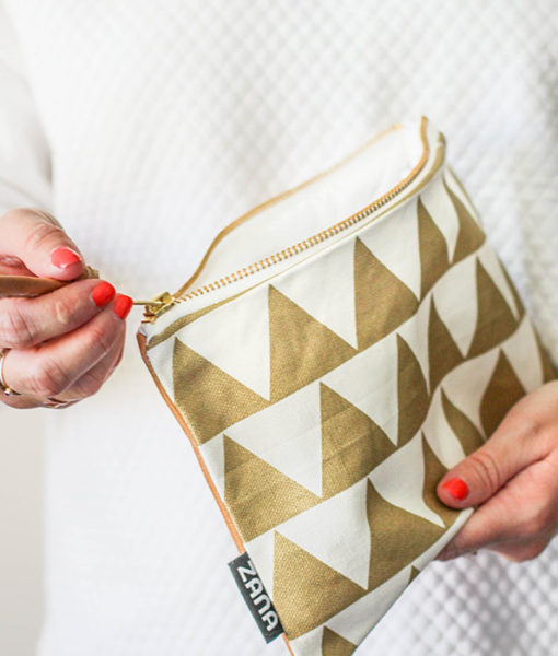 zipper closure on gold triangle leather clutch by zana south africa