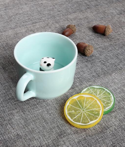 lifestyle photo with panda - ceramic mug in mint