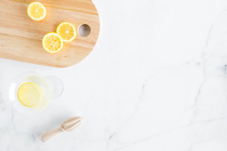 sliced lemons to make a summer sun lemon thyme cocktail