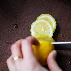 slicing lemon – summer sun lemon thyme cocktail by pop shop america