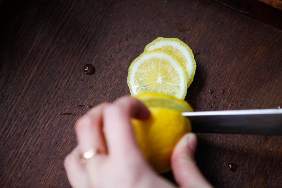 slicing lemon - summer sun lemon thyme cocktail by pop shop america