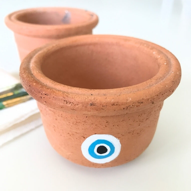 adding-more-white-paint-hand-painted-evil-eye-pot-pop-shop-america_square