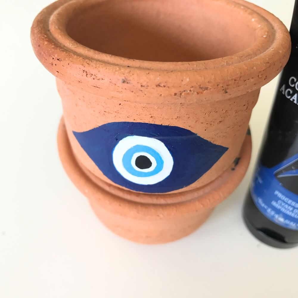 detail of evil eye planter diy by pop shop america