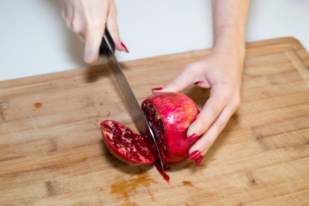 cutting-pomegranate-rainbow-unicorn-fruit-parfaits