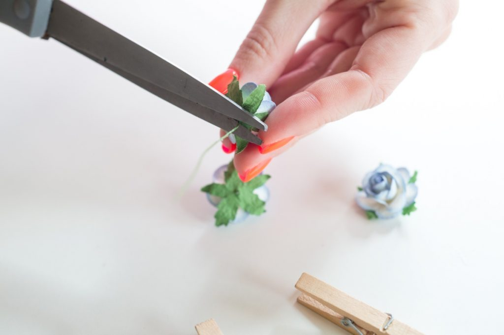 cut the paper flowers to make diy flower clothespins