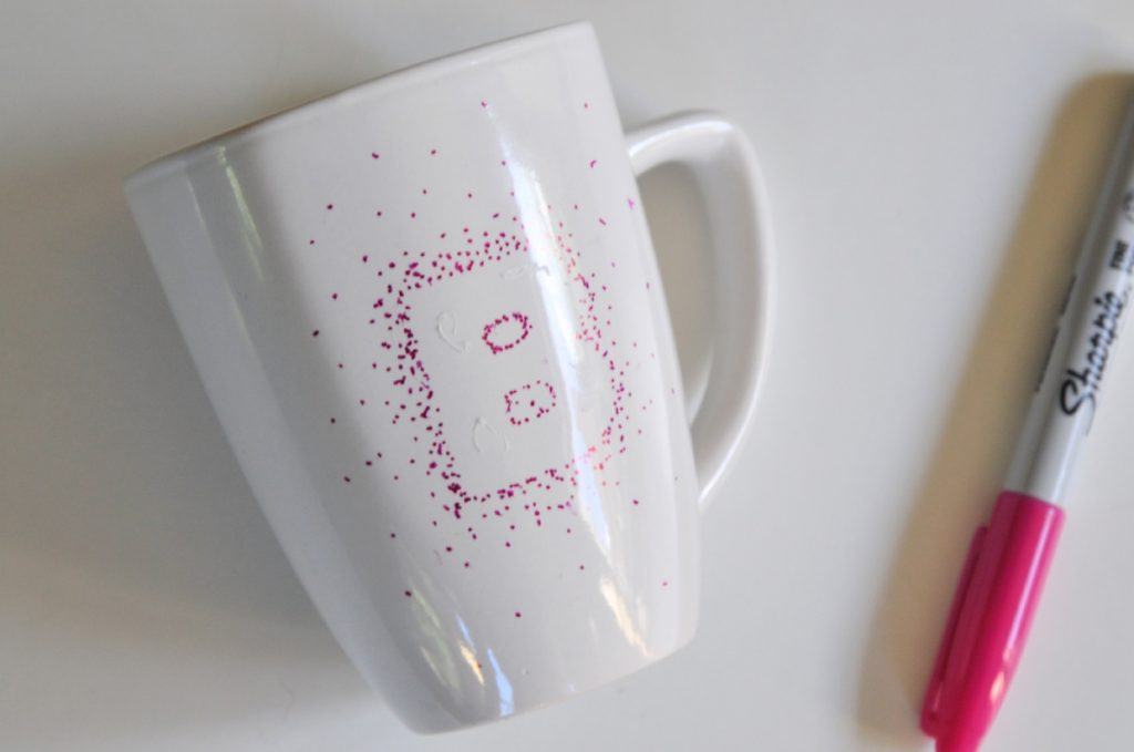 finished stippling dots effect on coffee mug