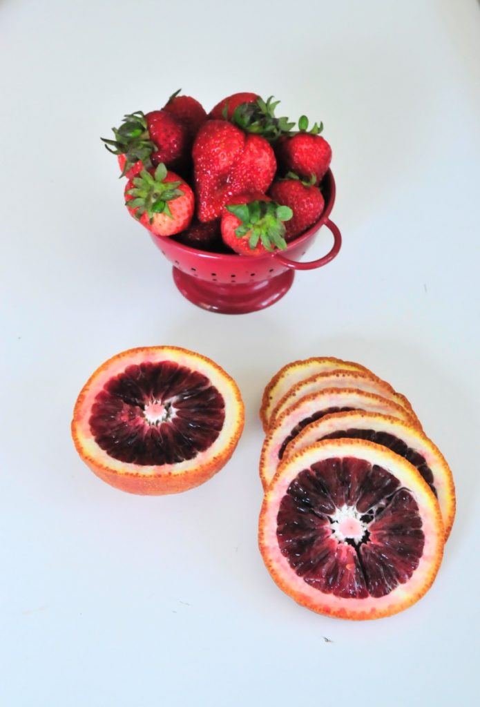 slice the blood oranges and strawberries to make white sangria
