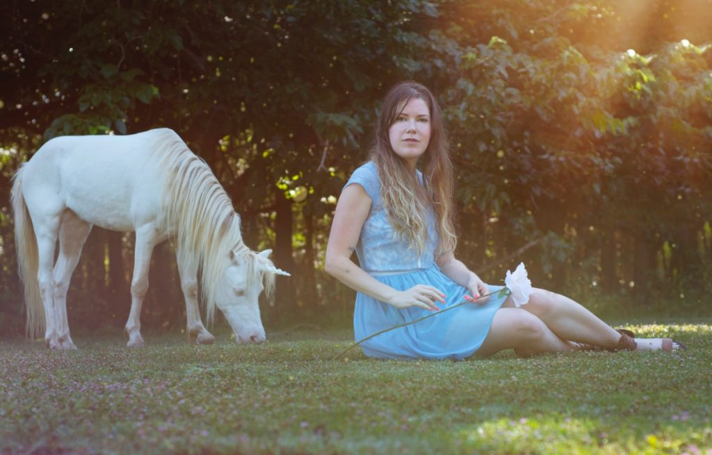 unicorn in a meadow with brittany bly photograph