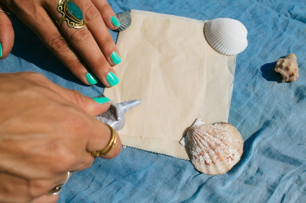 add a small dab of e6000 to make diy seashell barrettes