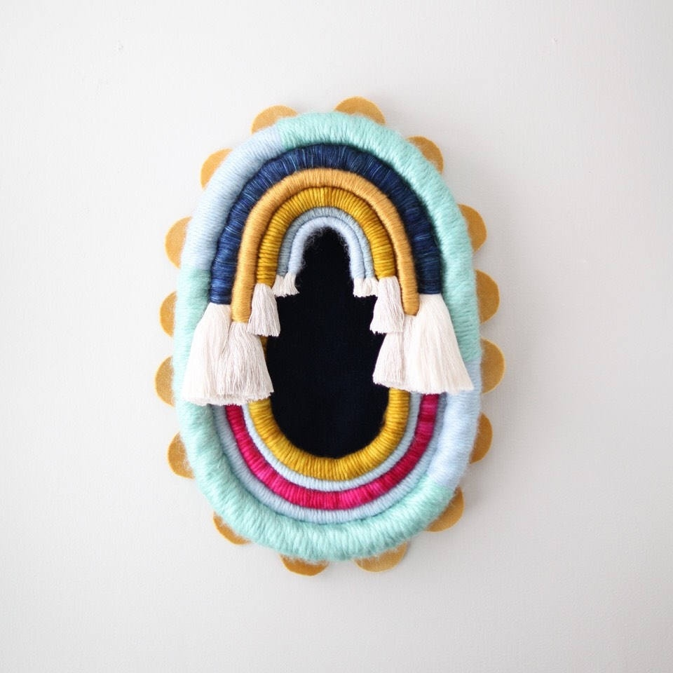 rainbow oval woven wall hanging by mandi smethells