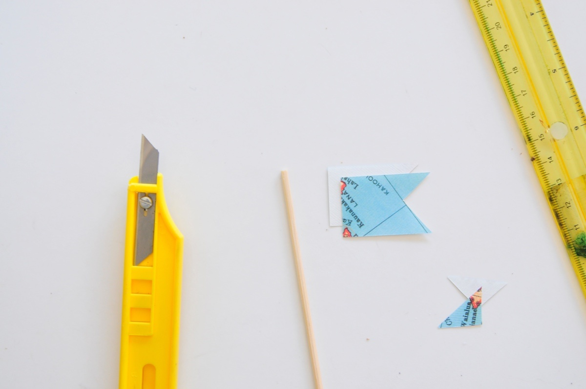 detail of supplies for diy swizzle sticks with maps