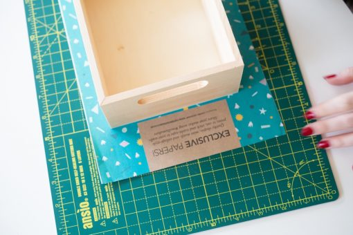 add paper behind the wooden box with mod podge