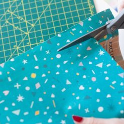 cut the paper to make a diy calendar craft tutorial
