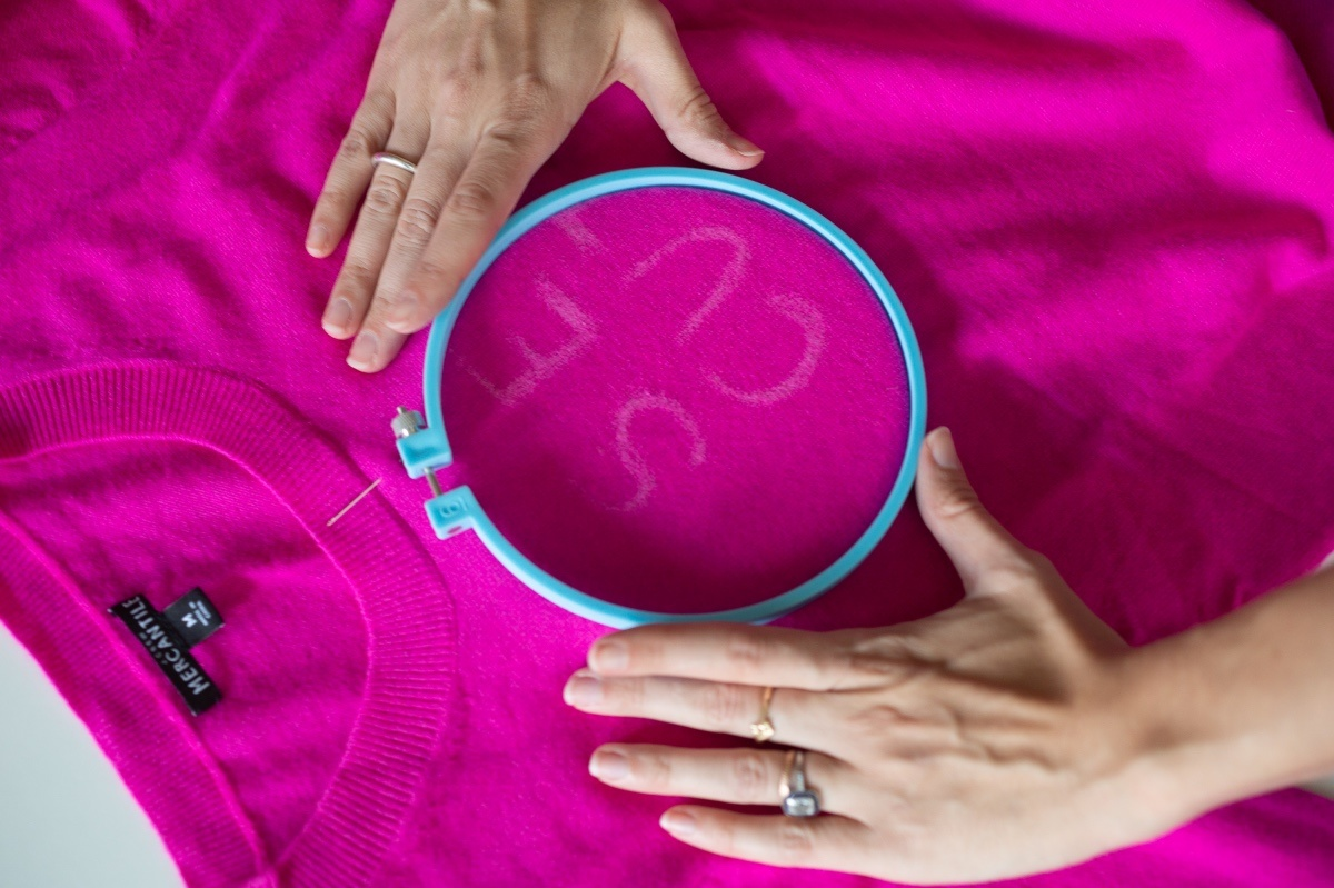 stretch the fabric to create embroidered letters on a sweater