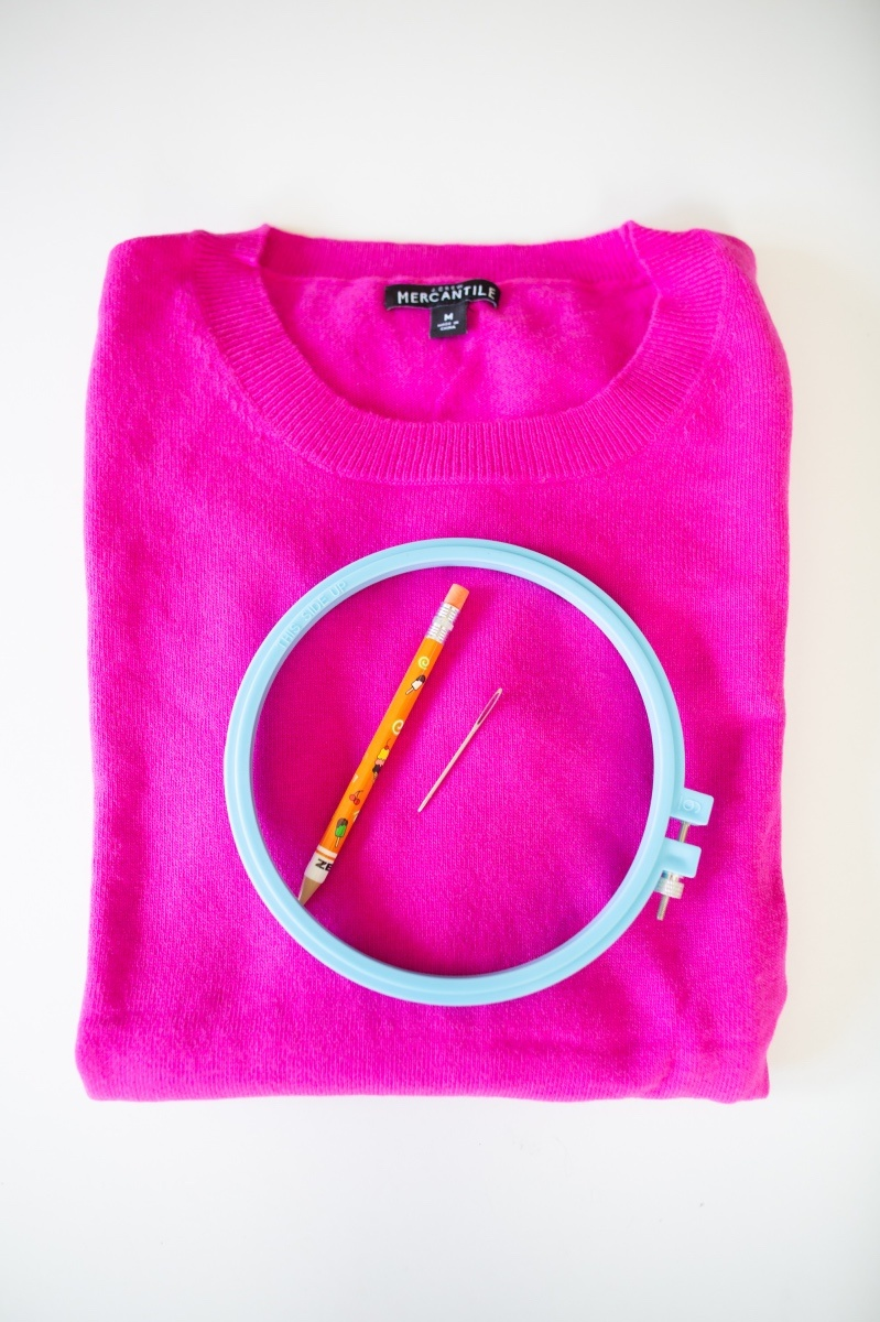 sweater and embroidery hoop supplies to make an embroidered sweater