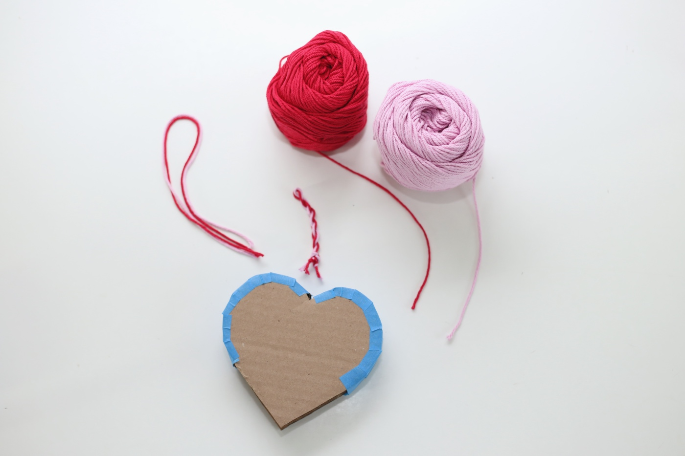 add a twist of yarn to the top mini heart pinata diy