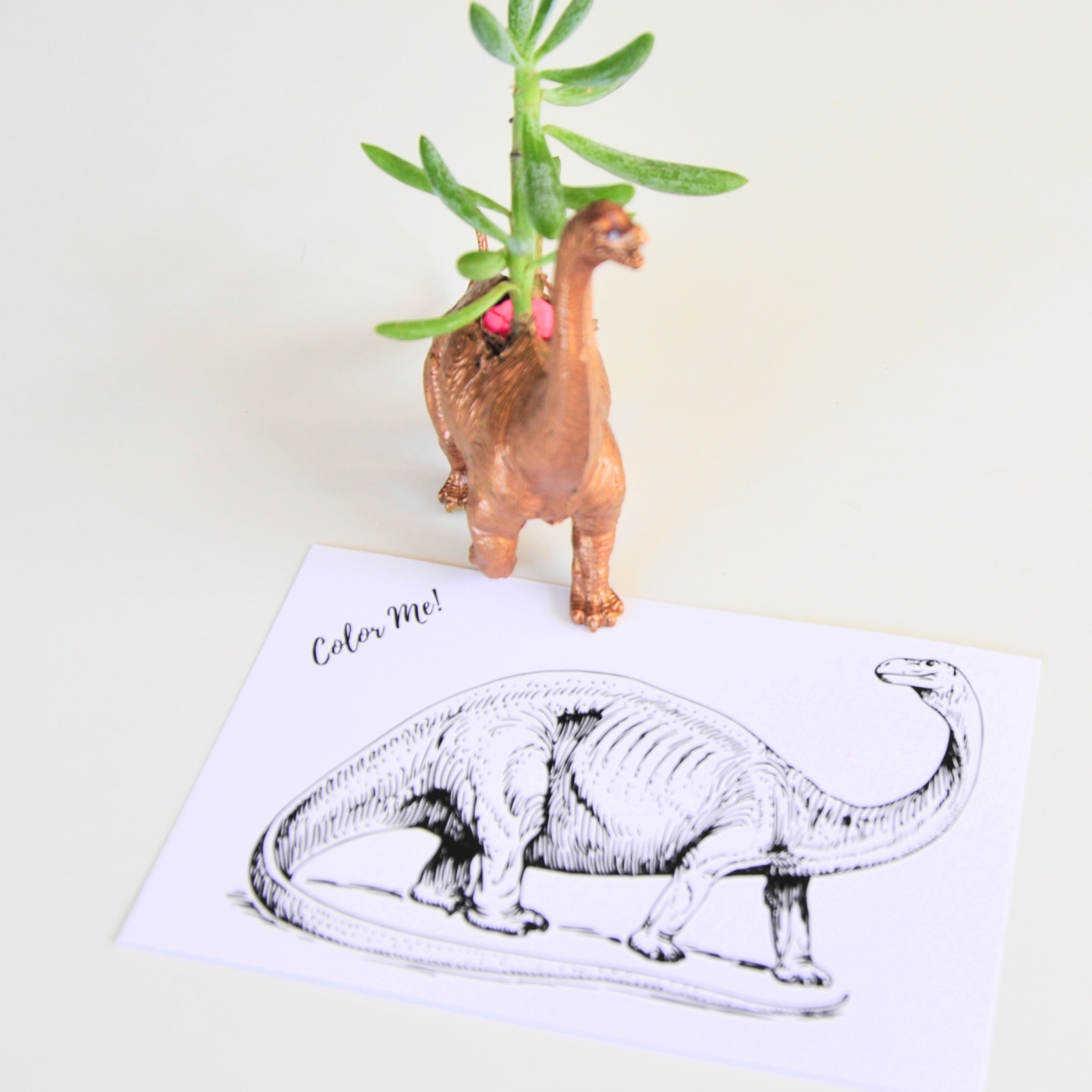 gilded dinosaur with free brontosaurus coloring postcard pop shop america