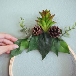 placing-the-leaves-and-plants-pop-shop-america-wreath-diy_square