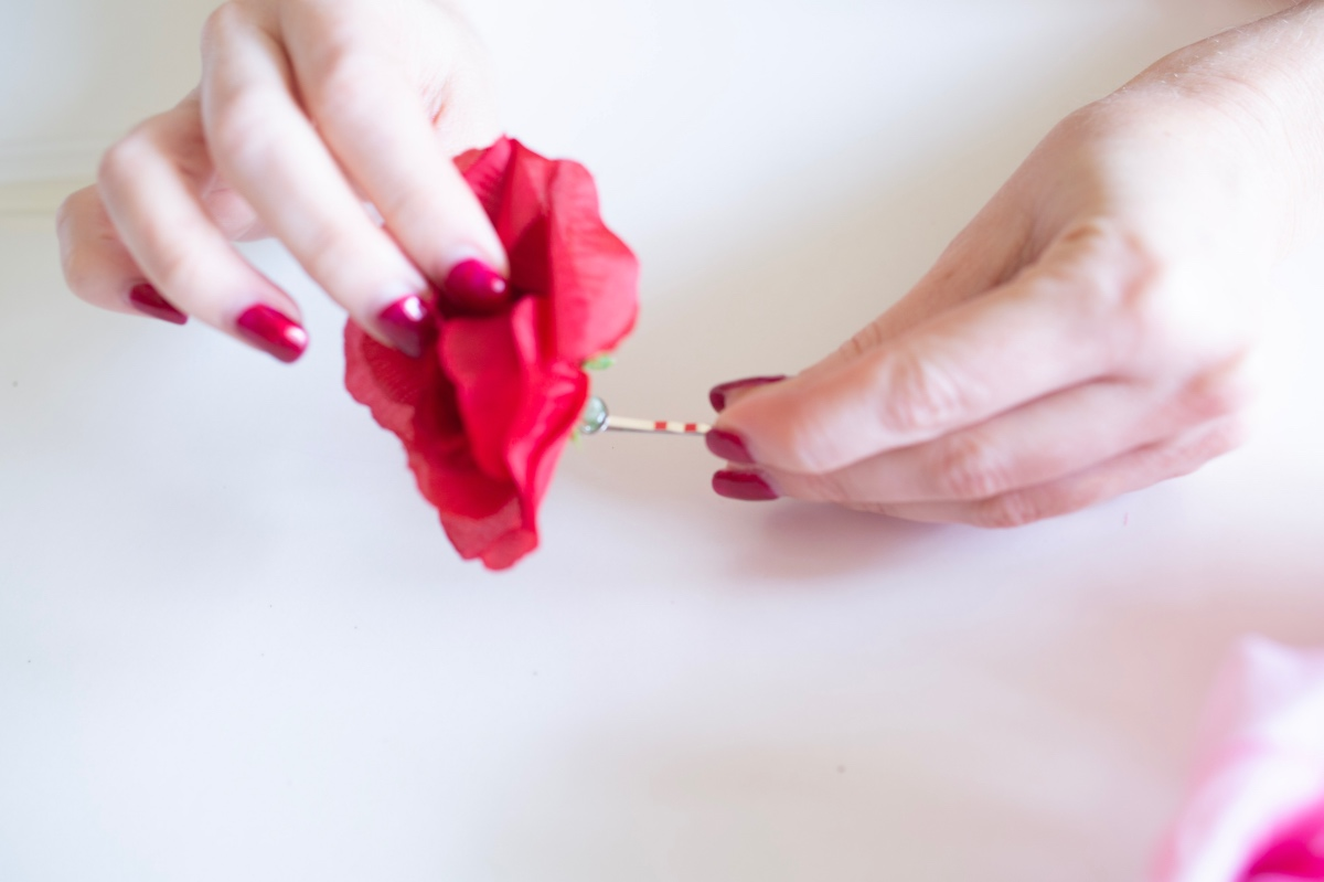 adding the silk flower to the hair clip diy flower crown tutorial