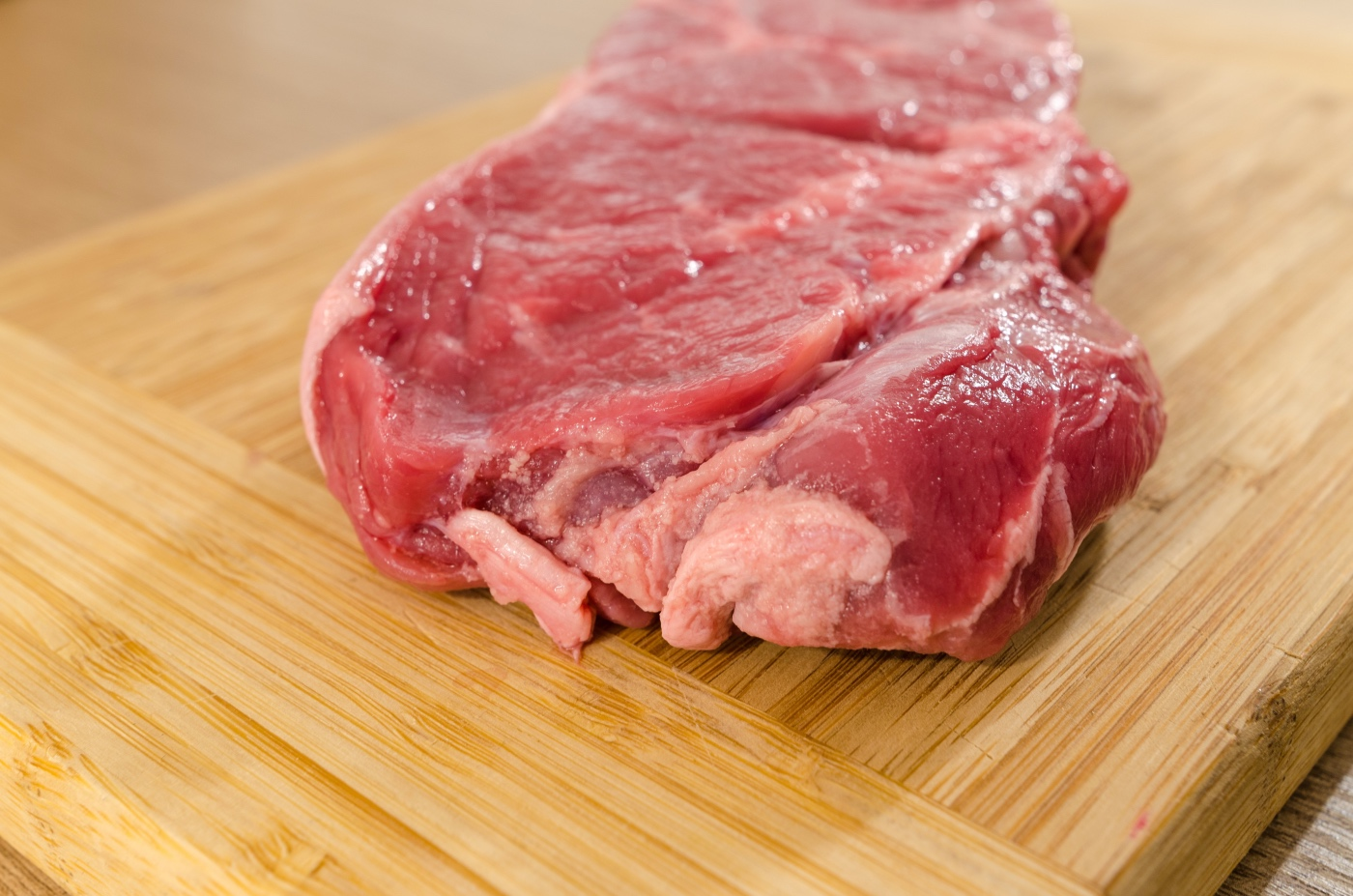 raw steak before simple garlic steak marinade is added pop shop america