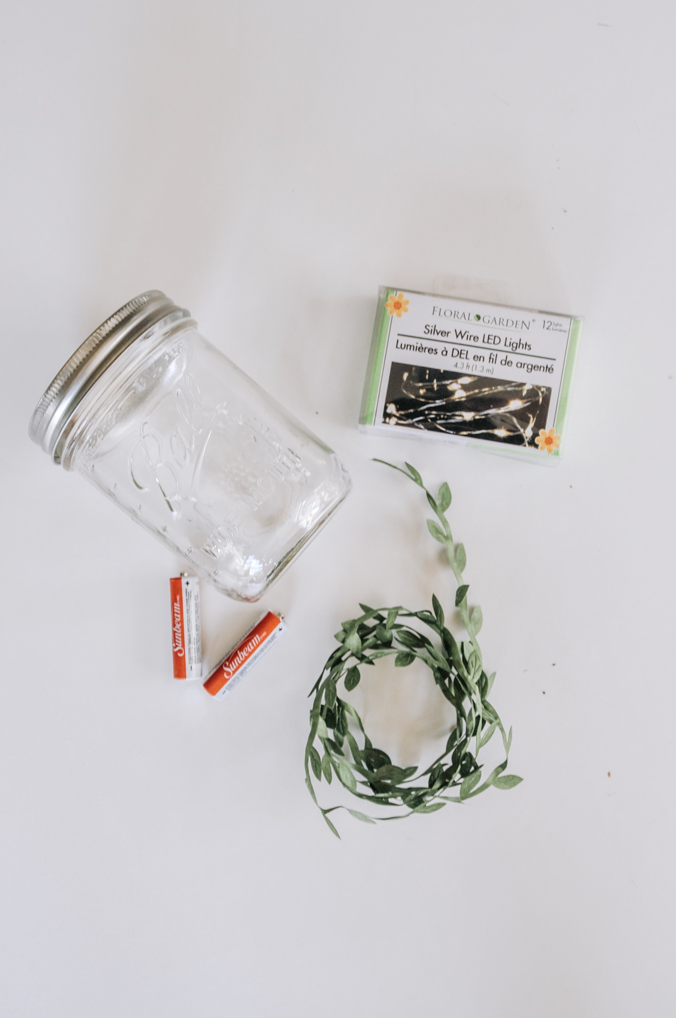 supplies to make a mason jar light diy with green ivy