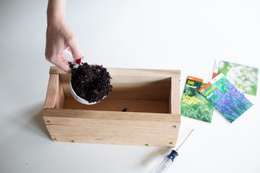 add soil to the diy wood planter box - gardening diy tutorial