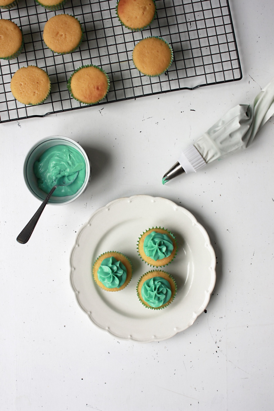adding green frosting to the buttermilk cupcakes pop shop america