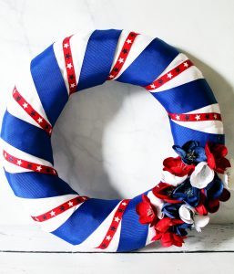 adding flowers to diy patriotic wreath