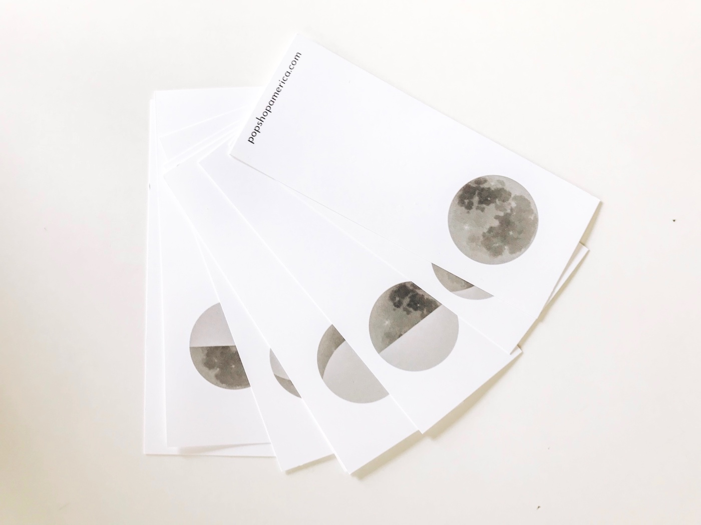 how-to-attach-the-moon-phase-flip-book-pop-shop-america_bright